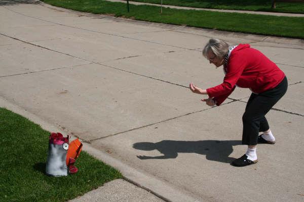 Chicken being coaxed to death/Ryn Gargulinski