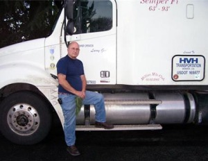 Larry with current truck - his old one lasted more than 1 million miles/submitted photo
