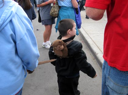Kid on leash in context of Fourth Avenue street fair/Ryn Gargulinski