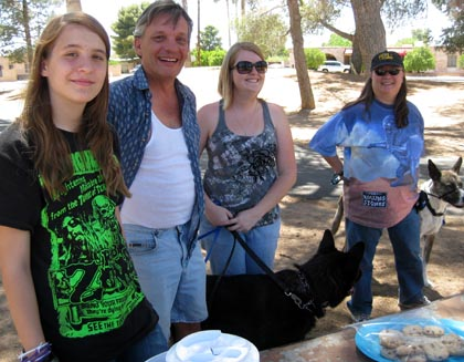 Reid Park picnic: Andrew Ulanowksi with daughter Andrea (left), Jenna Loomis with Dante, Deb Ross with Scout/Ryn Gargulinski
